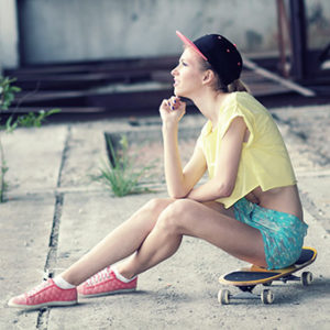 Teenager with skateboard portrait outdoors
